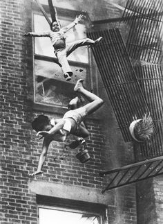 """July 22, 1975 — """"Fire on Marlborough Street"""" This harrowing picture was awarded a Pulitzer Prize in 1976 for spot news photography and depicts two people, 19-year-old Diana Bryant and her 2-year-old goddaughter, Tiare Jones, falling from the collapsed fire escape of a burning apartment in Boston. Bryant died as a result of injuries sustained during the fall, but the young child lived."""