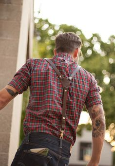 Dark denim, plaid flannel, rolled sleeves, leather and hardware suspenders.