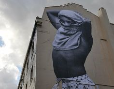 """Great read from Good, and I love the picture: """"one of the thousands of larger-than-life portraits that came out of street artist JR's TED Prize wish last year."""""""
