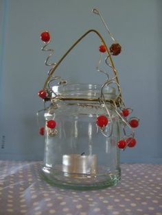 hanging tea light holder made with baby food jars. Maybe I could use some larger jars that I have.