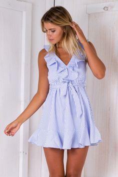 """The """"Sweet Sundays dress"""" is cute and casual! Featuring a frill front and back neckline, elastic waist, fresh striped pattern and sash tie waist. Style it with sandals and a wide brimmed hat for an afternoon picnic with the gals! Size 8, Length:80cm/31inches Width:31cm/12inchesPolyester Cold Hand Wash Only Model wears a size 8 Model's height 180cm  Prints may vary Imported A slight variation may occur in colours and size specifications. Colours may appear slightly d..."""