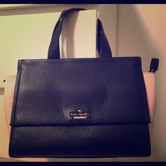 Gorgeous Kate Spade bag Brand new Kate Spade satchel with original tag attached and dustbag.  Color block- black & pink pebble leather.  Comes with long shoulder/ crossbody strap.  Roomy inside with zipper compartment and 2 pockets.  Zippered top.  Large magnetic closure pocket in the front & back.  Has a couple small dents in the leather in the front of the bag (possibly from storage), which it came with when purchased from Kate Spade.  Adorable & functional bag!!   ***Price is firm…