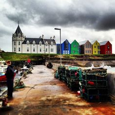 John O'Groats, Scotland: the northernmost place in Great Britain.  Pictured:  The new Inn at John O'Groats.  Let's go!