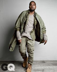 "Break New Ground (But Keep It Grounded) Kanye's Take: ""Military green is classic, masculine, not too trendy—all the stuff men's clothes are supposed to be.""     Military shirt, $1,055 by Balmain T-shirt, $55 by James Perse Pants, $575 by Michael Bastian Boots, $190 by Timberland Coat, vintage"