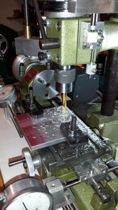 Unimat SL 1000 modification includes a milling/drilling head with digital depth indicator and adjustable drill stop.