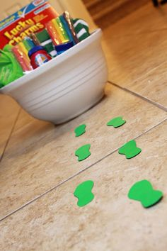 leprechaun surprise - Green paper footprints leading to Lucky Charms, green t-shirts, and goodies.