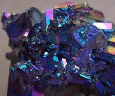 chalcopyrite that has been treated with acid to make it tarnish to these colors of blue, purple and red