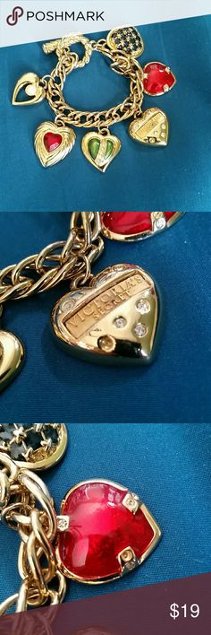 VS Heart Charm bracelet vintage  90s BEAUTIFUL heart charm bracelet.  ALL MY GRANDS WANT THIS - but i saved it for YOU!   In decent condition with minimal  missing stones see pics. Some wear shows due to age .see pics   Gold tone with enamel and rhinestone  heart charms. Jewelry Bracelets
