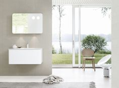 The Dansani Curvo bathroom furniture and mirror cabinet floating in perfect harmony. Mirror Cabinets, Wall And Floor Tiles, Shower Enclosure, Bathroom Furniture, Radiators, Flooring, Lighting, Design, Home Decor