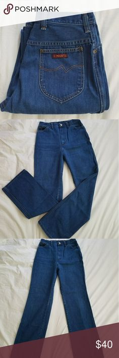 Vintage Wrangler's Jeans These beautiful Vintage jeans are USA made and in excellent condition! The have a fabulous blue color, nice High waist, and long length! They are labeled a size 12 misses but as with all vintage denim the sizing is quite different. I have them listed as a 27 due to waist measurement. But Please refer to pics for approx measurements, and feel free to ask for any additional. Wrangler Jeans Boot Cut