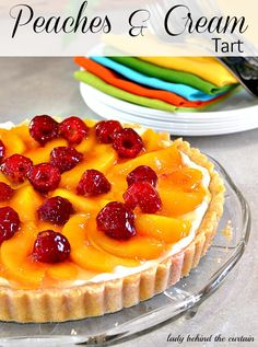 A wonderful tart with a almond and macaroon crust filled with a almond flavored cream and topped with fruit.  This peaches & cream tart light dessert i