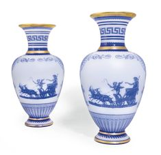 A pair of Baccarat acid-cameo blue-cased opaline glass vases, circa 1870