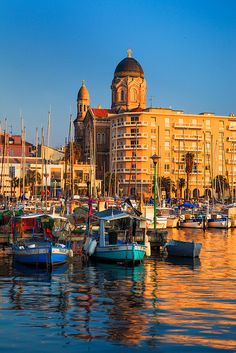 Golden Harbour - A harbour in Saint Raphael reflects the evening light, giving the water a golden appearence. Saint Raphael has been a popular holiday destination on the French Riviera for many years. There is evidence that the Romans used to holiday in Saint Raphael.