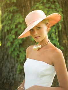 White strapless dress by Oscar de la Renta. Gorgeous southern bride with hat and oversized pearls.