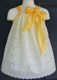 lace pillowcase dress with satin ribbon.