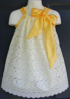 lace pillowcase dress with satin ribbon.