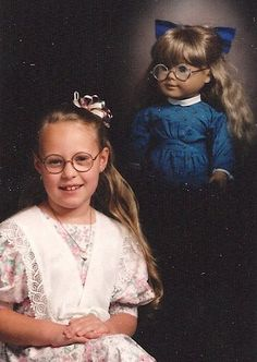 """""""This photo is from my 8th birthday. My grandmother bought me this American Doll for Christmas the year prior, along with glasses to """"make me feel better"""" about getting some myself, and she apparently thought it was a good idea to be photographed with the doll on birthday. Wow, Grandma, the doll hovering over my [...]"""
