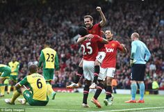 Antonio Valencia and Chicharito help Juan Mata celebrate his goal.