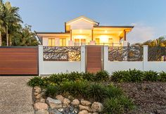 Front wall with external post tops and laser-cut infills House Styles, Front Landscaping, Modular Walls, House Painting, Feature Wall, House Paint Exterior, Outdoor Living, Wall Systems, Boundary Walls