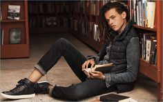 Don Lee layers with a POLO Ralph Lauren vest and denim jacket. The model's look is complete with skinny jeans and leather high-top sneakers.