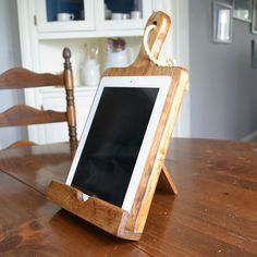 Rustic Wood iPad Stand For The Kitchen Cutting Board by Roostic, $35.00 -- Oh, definetely need this for easier recipie reading!