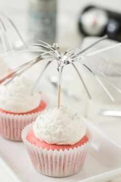 Pretty pink champagne cupcakes filled with a creamy pastry creme and topped with a sweet champagne frosting.