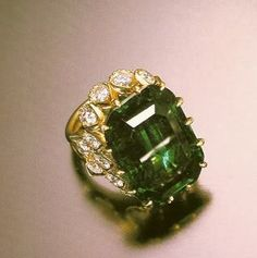 "the Duchess of Windsor's 19.77-carat emerald engagement ring with inscription: ""We are ours now″ (Cartier)"