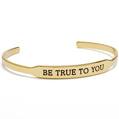 "With the Trolls ""BE TRUE TO YOU"" Gold Happygram™ Bangle, remembering to be the one and only YOU will be quite simple: just look down at your wrist and hug it out! Featuring an engraved phrase taken from DreamWorks Animation feature film, ""Trolls,"" this simple and stunning Bangle was designed with an open back, allowing it to be adjusted to size."