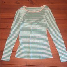 Long sleeve tee Grey and teal long sleeve tee only worn a few times! Super comfortable, I have one in grey. I just never wear stripes. Old Navy Tops Tees - Long Sleeve