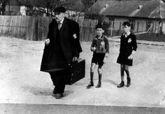 Hajduboszormeny, Hungary, A man and two children on their way to the ghetto.