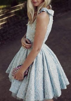 Pastel blue dress.  The detailing is tasteful and classic, but the color and short length makes it modern and fun.