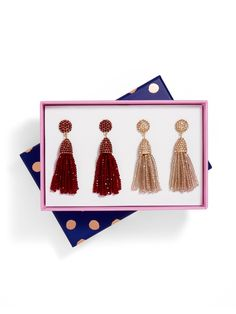 A delicate fringe and lustrous beading lends a classic glam vibe to this sleek silhouette. Duo includes two pairs of earrings.