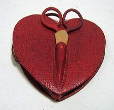 Heart-shaped sewing kit with scissors on outside - exterior view.