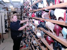 SHOE WALL - Ann Watson, costume shop supervisor for the Johnny Carson School of Theatre and Film, sorts shoes in a...