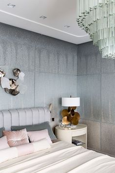 This Master Bedroom design is chic with sumptuous materials and a gorgeous channeled headboard. Designed by CATHERINE FEDORCHENKO