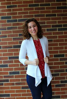 Tone down bold polka dots with a modern cut cardigan and basic blue jeans