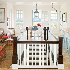 11 Stylish Staircases Interesting idea to use the staircase to divide the room areas. Thinking outside the box to not have hug an adjacent wall. Open Basement Stairs, Basement Steps, Open Stairs, Basement Kitchen, Coastal Living Rooms, Basement Remodeling, Remodeling Ideas, Kitchen Living, Stairways