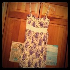Lovely floral Speechless Dress, 9 Loved little dress featuring an ivory material with pretty purple lilacs all over it. Has an under slip that is also ivory, as well as adjustable straps so it will work for different heights! Has ties in the back and a lace band under the bust. The top is also padded. I wore this once, for my high school graduation and sadly outgrew it. Id love for someone new to enjoy this great little country-style frock! Perfect for fancy summer parties, grad parties, or…