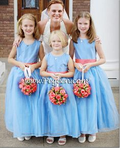 We recently received the photos from the bride for her Melon and Blue Moon Silk Flower Girl Dresses silk and organza Style 394. Her dress back has a Cinderella bow in melon.  #bluemoon #blueorganza #coral #mediumblue #melon #melonandblueflowergirldresses #peach #style394 #bluewedding #wedding #flowergirldress #flowergirl #jrbridesmaidsdress #flowergirldresses #pegeendotcom #pegeen.com #silk #organzaflowergirldresses #coutureflowergirldresses #couture We sell exclusively onl