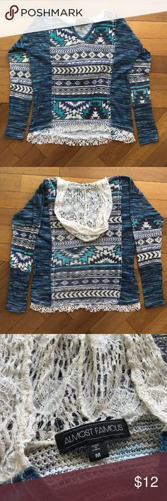 Almost Famous long sleeve with hood Blue and white long sleeve shirt with fringe hem and lacey hood. 100% polyester. Size Medium. Almost Famous Tops Tees - Long Sleeve