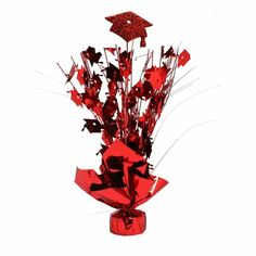 A great accessory for any table the graduation cap centerpiece is styled just right to look great.  With A glittery graduation cap on the top and lots of smaller graduation caps on all the  branches this grad cap centerpiece is just what you need for your graduation party.  Be sure to get a graduation centerpiece for every table, at these prices there is no reason not to accessorize every table with a great table centerpiece.