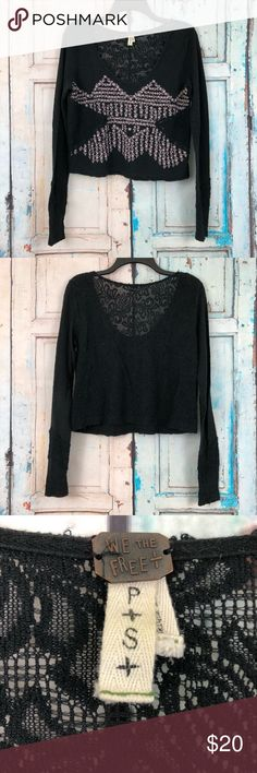 We the Free Lace Crop Top We The Free long sleeved crop top. Super cute Free People top. Has purple floral design with lace cutouts. Long sleeve with lace cutouts at wrist, and a lace back. Size S, colors are black and purple with black lace. Fabric 100% cotton. Free People Tops Crop Tops
