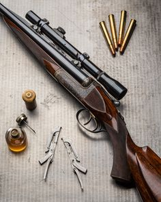 gentlemanbobwhite.375 H&H belted magnum droplock double rifle made in 1953