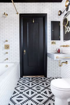 bathroom with bold black and white geometric tile floor