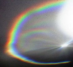 make a rainbow by using a flashlight and coffee pot filled with water