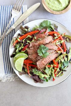 A low-carb alternative to a favorite mexican dish. This fajita steak salad is loaded with sauteed peppers and onions and topped with a creamy avocado dressing. A guilt-free, delicious meal. Click the link to learn more. Barbecue Recipes, Beef Recipes, Real Food Recipes, Cooking Recipes, Sauteed Peppers And Onions, Creamy Avocado Dressing, Flat Iron Steak, Steak Salad, Steak Fajitas