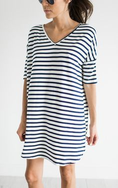 staying casual and comfy in a striped v-neck dress