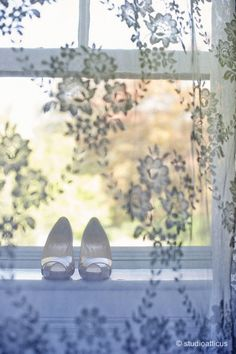 Beautiful wedding shoe photography through lace curtain. Love.