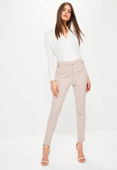 Revamp your workwear 'drobe with these pants. Featuring a cigarette style, blush pink hue and ring zip details, this piece will take you from desk to drinks!