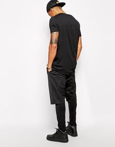 Aumentar Pantalones cortos de punto con acabado en malla y diseño más largo de ASOS